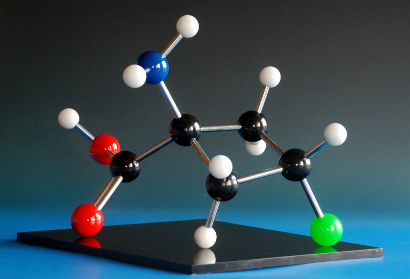A large molecular model of the drug Fluciclovine, made with phenolic balls and aluminium rods on an acrylic base