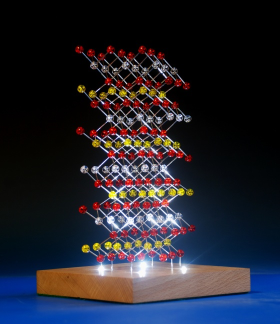 illuminated molecular model of Lithium cobalt oxide on a wood base with integral lighting