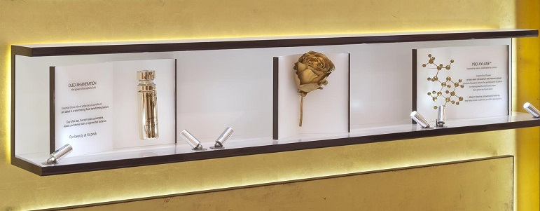 l'oreal display with gold molecular model